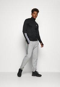 adidas Performance - AEROREADY PRIMEGREEN TRAINING - Sports shirt - black/white - 1