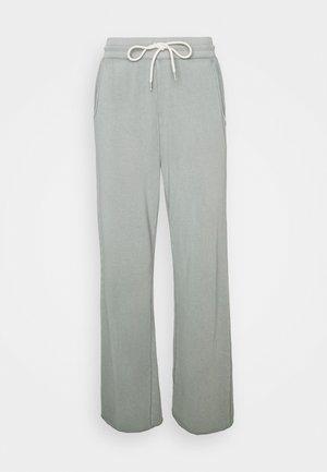 Pantalon de survêtement - gasoline green