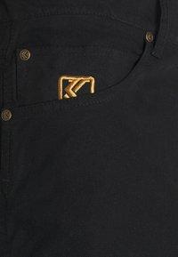 Karl Kani - OG PANTS UNISEX - Cargo trousers - black - 5