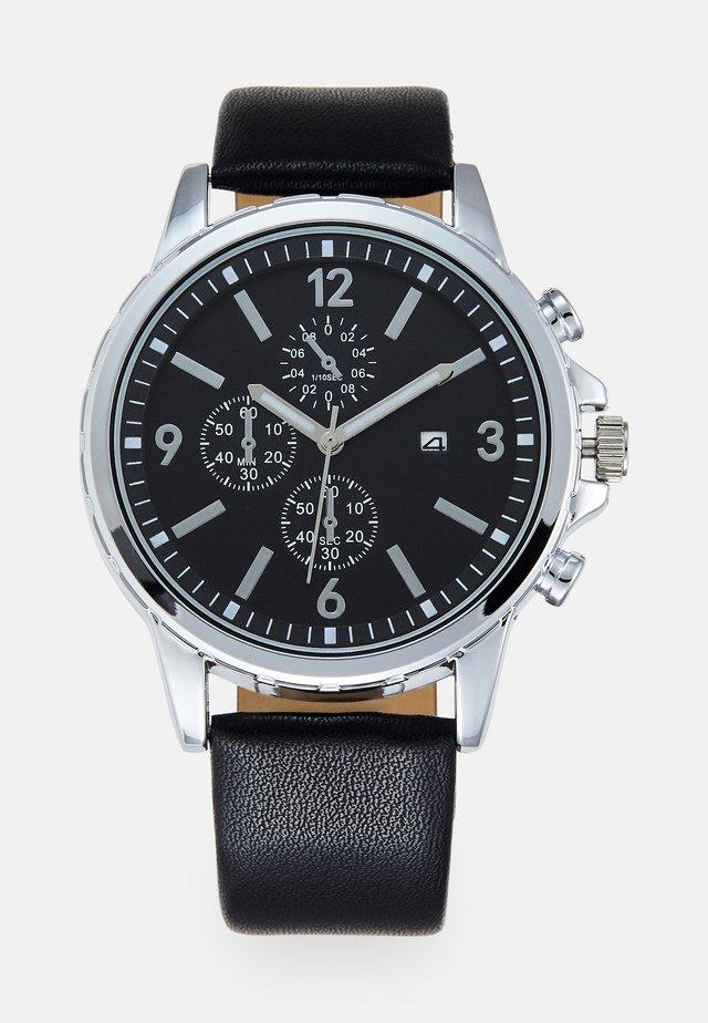 Klocka - black/silver-coloured