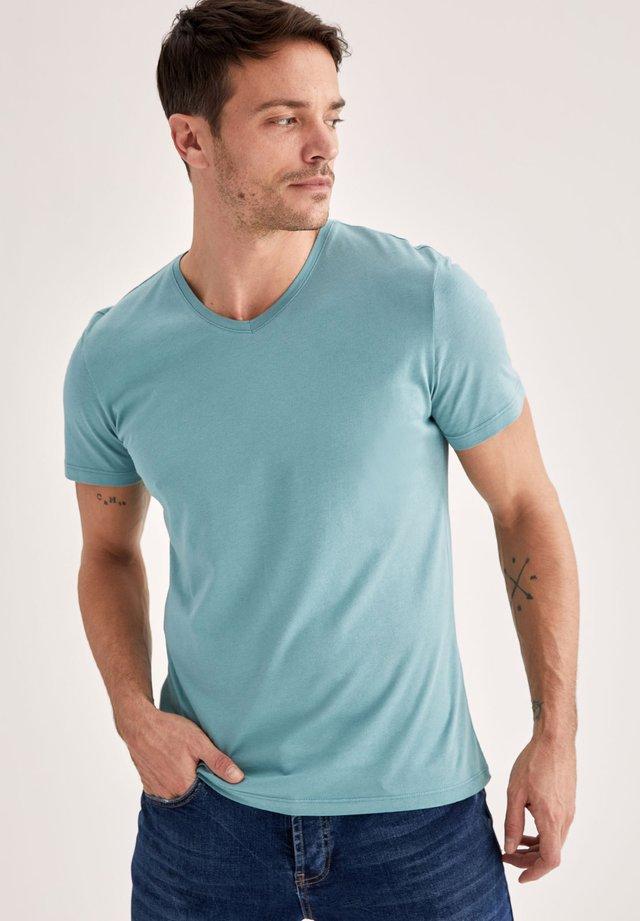 SLIM FIT - T-shirt print - green