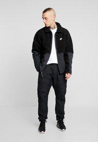 Nike Sportswear - WINTER - Let jakke / Sommerjakker - black/off noir - 1