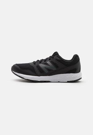 YK570 UNISEX - Neutral running shoes - black