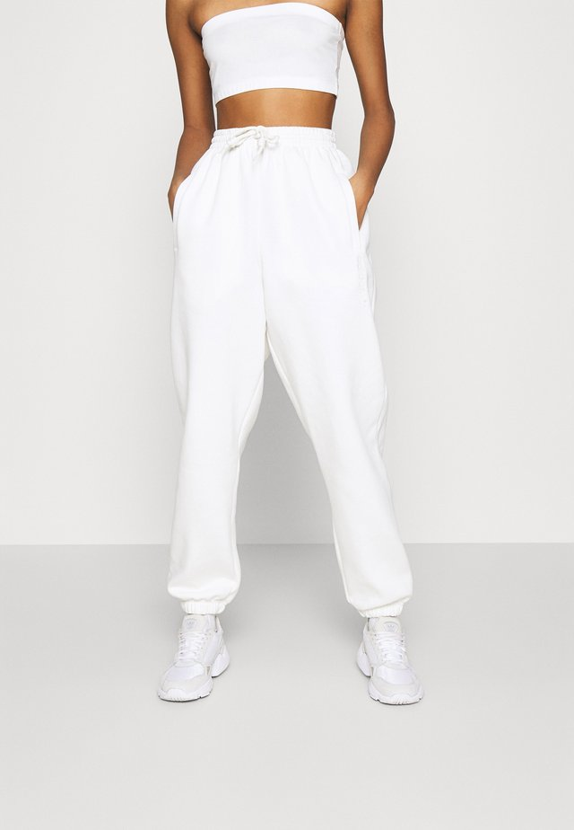 PANT - Verryttelyhousut - off white