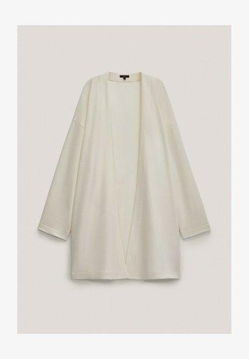 MIT TASCHEN - Cardigan - beige