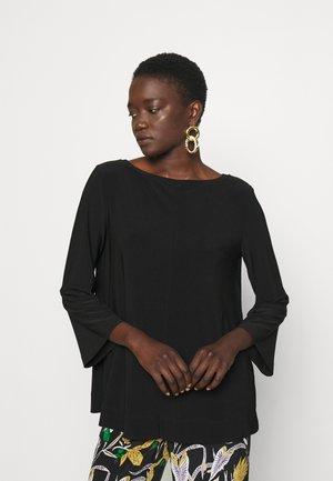 RIVOLO - Long sleeved top - black