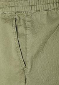 Jack & Jones - JJIGORDON JJLANE - Tracksuit bottoms - deep lichen green - 2