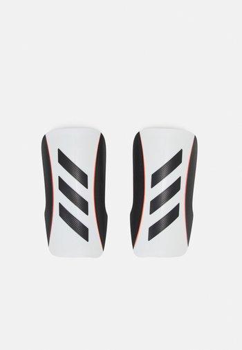 TIRO - Leggbeskyttere - white/black