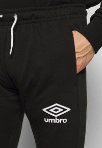 Umbro - TAPED JOGGER - Pantaloni sportivi - black - 4