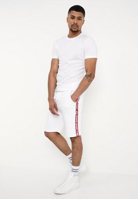 Alpha Industries - TAPE JOGGER - Tracksuit bottoms - white - 1