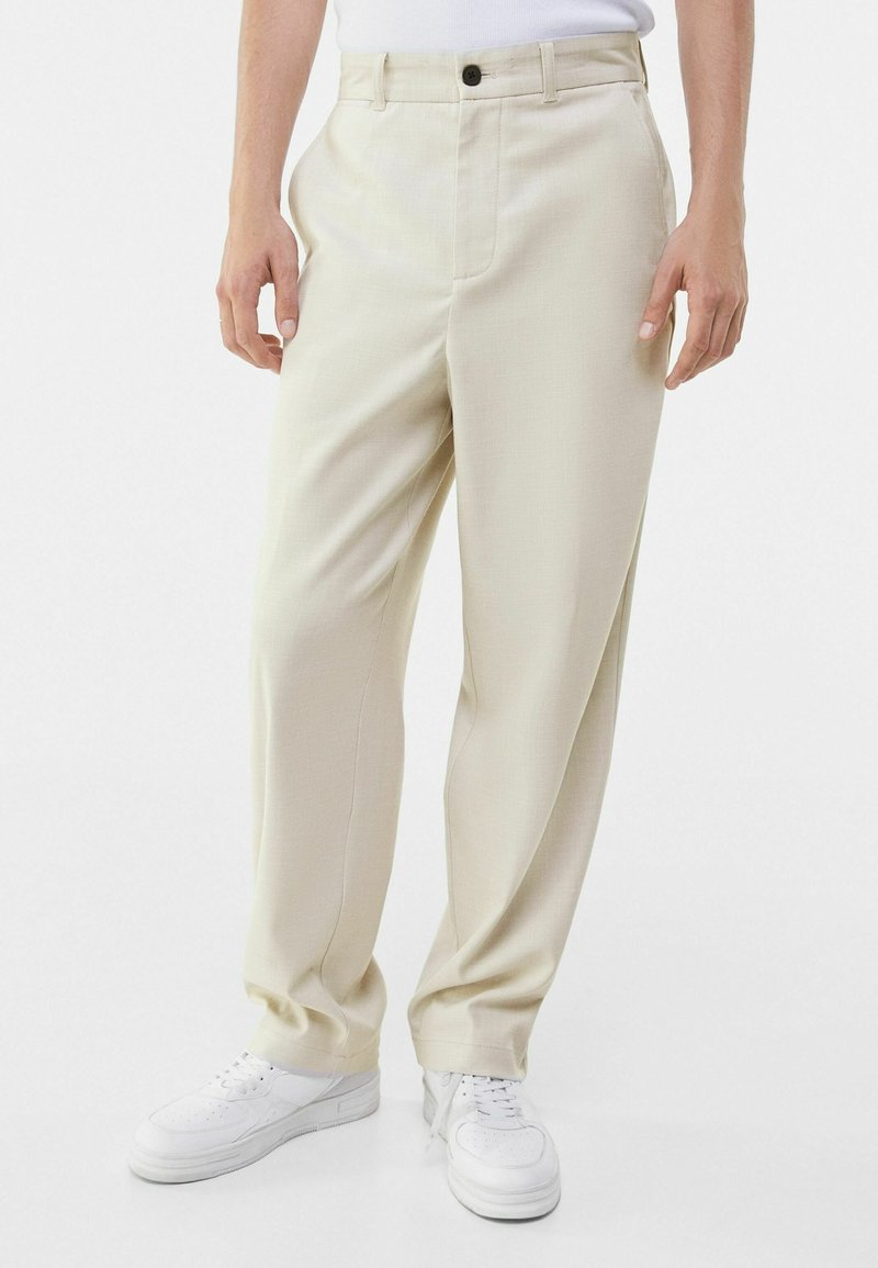 Bershka - WIDE FIT - Trousers - sand