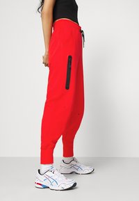 Nike Sportswear - Tracksuit bottoms - chile red/black - 4