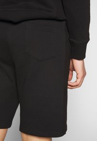 Russell Athletic Eagle R - FORESTER - Tracksuit bottoms - black - 3
