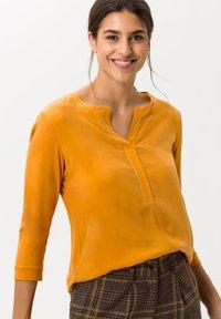 BRAX - STYLE CLARISSA - Long sleeved top - butternut - 1
