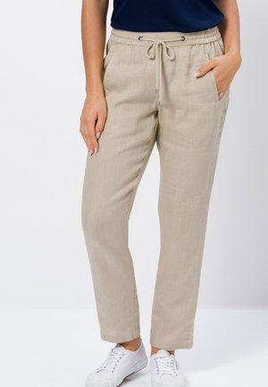 MIT BINDEDETAIL - Trousers - beige