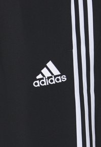 adidas Performance - Pantalon de survêtement - black - 5