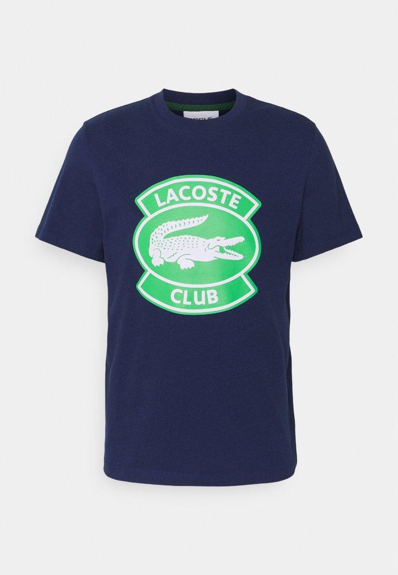 Lacoste - T-shirt med print - scille