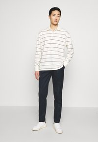 Tommy Hilfiger - TAPERED SUMMER FLEX - Trousers - blue - 1