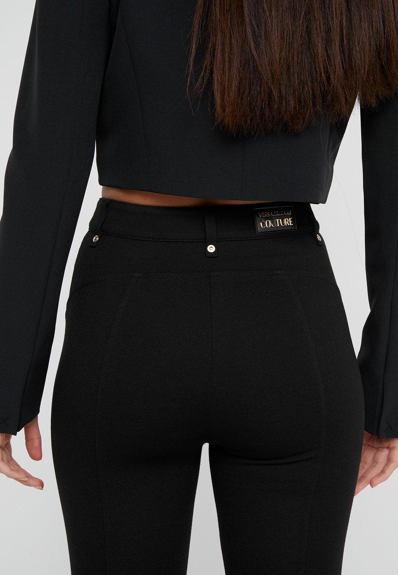 Versace Jeans Couture Trousers Nero Black Zalando Co Uk