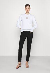 Versace Jeans Couture - Jeans Skinny Fit - black denim - 1