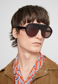Gucci - Gafas de sol - black/brown - 1