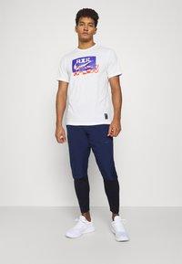 Nike Performance - Pantalones deportivos - midnight navy/black - 1
