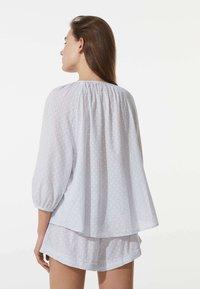 OYSHO - PLUMETI - Pyjama bottoms - blue - 1