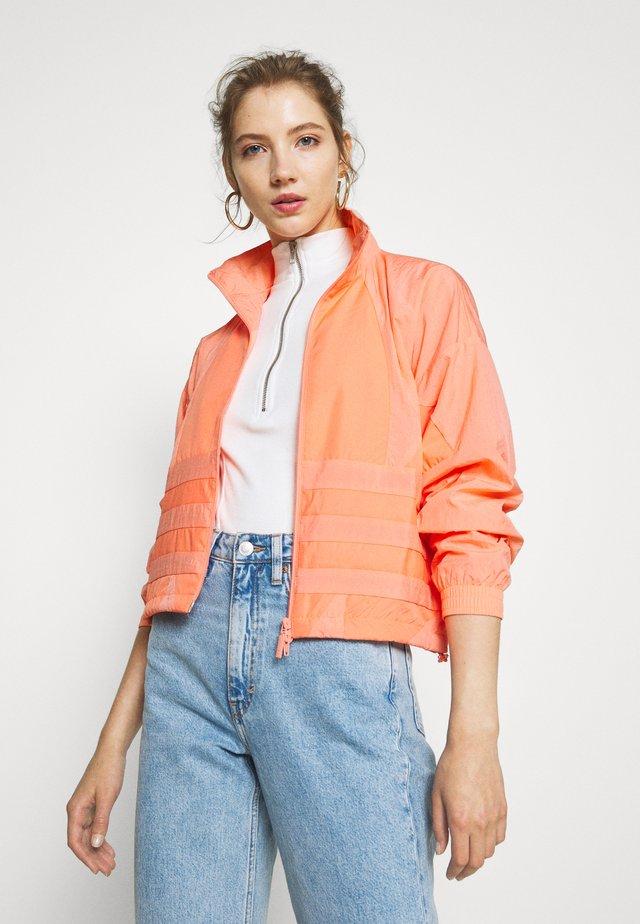LOGO - Sportovní bunda - orange