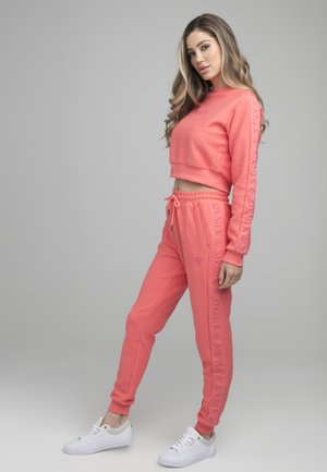 SIKSILK LOOPBACK EMBROIDERED JOGGERS - Tracksuit bottoms - pink