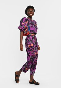 Desigual - DESIGNED BY M. CHRISTIAN LACROIX: - Trousers - red - 1