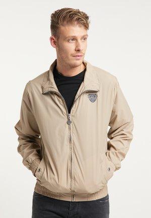 WINDBREAKER - Summer jacket - beige