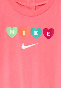 Nike Sportswear - RUFFLE SLEEVE  - Jumpsuit - sunset pulse - 2