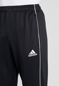 adidas Performance - CORE - Tracksuit bottoms - black/white - 3