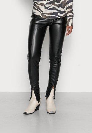 CARRIE SLIT  - Leggings - black
