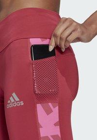 adidas Performance - OWN THE RUN CELEBRATION RUNNING LANGE TIGHT. - Leggings - pink - 3