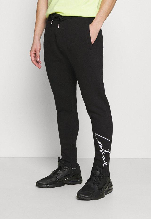 ESSENTIALS - Teplákové kalhoty - black