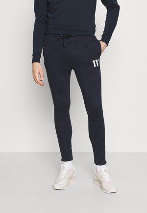 CORE SKINNY FIT - Teplákové kalhoty - navy