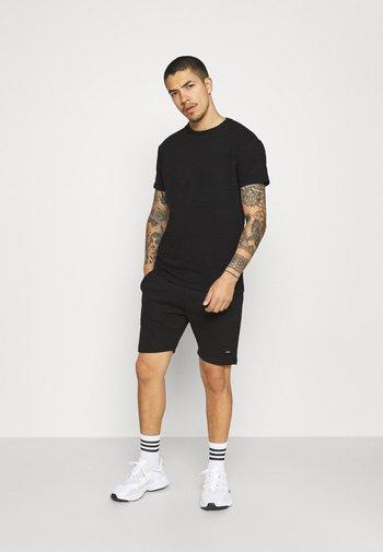AIM TWINSET - Shorts - black