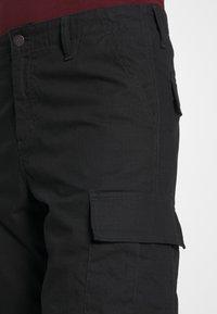 Carhartt WIP - REGULAR CARGO COLUMBIA - Shorts - black - 5