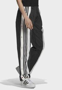 adidas Originals - Dry Clean Only xDENIM ADIBREAK - Flared jeans - black - 2