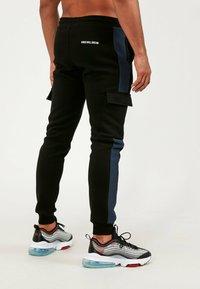 Kings Will Dream - Cargo trousers - black/navy - 2