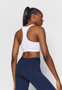 Ellesse - PRESELLE - Medium support sports bra - white - 2