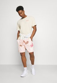 Nike SB - SUNDAY UNISEX - Tracksuit bottoms - orange pearl/coconut milk - 1