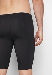 Puma - SWIM MEN JAMMER - Swimming trunks - black - 1