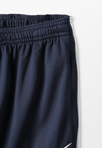 Nike Performance - DRY - Tracksuit bottoms - obsidian/white - 2