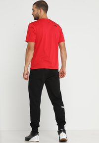 The North Face - LIGHT PANT  URBAN - Spodnie treningowe - black/white - 2