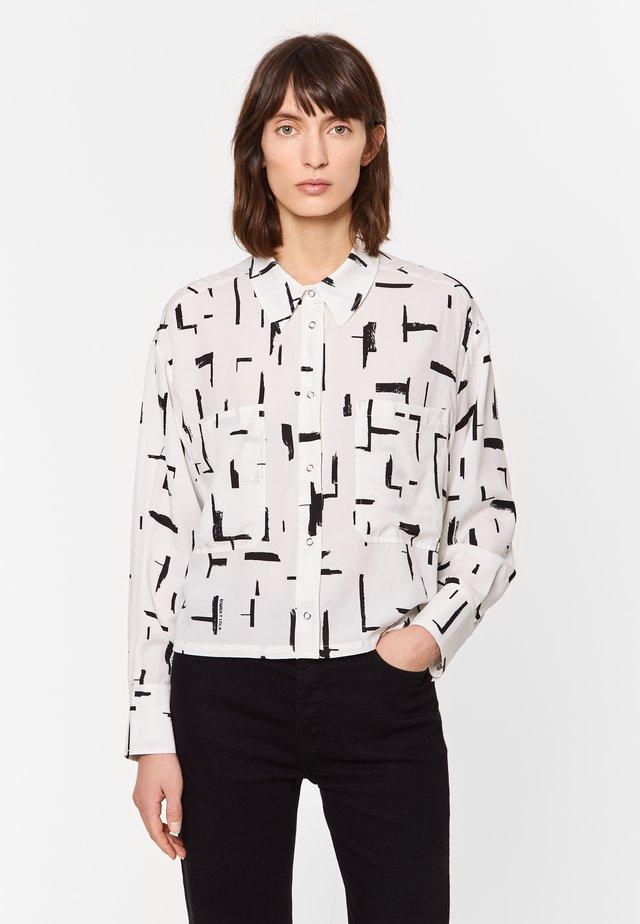 Overhemdblouse - paper lines white