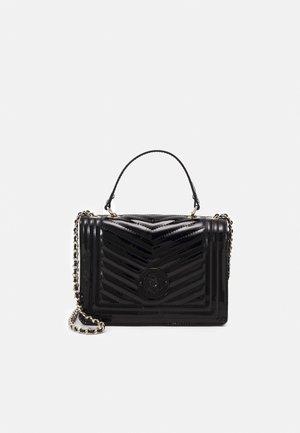 LIDA CONVERTIBLE XBODY FLAP - Handbag - black