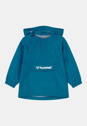 OJO UNISEX - Vodotěsná bunda - mykonos blue