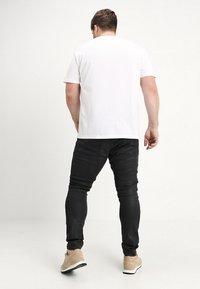 G-Star - 5620 3D SKINNY PM - Jeans Skinny Fit - loomer black rop stretch denim dk aged cobler - 2